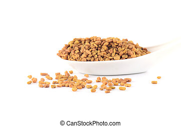 fenugreek seeds in spoon isolated on white background