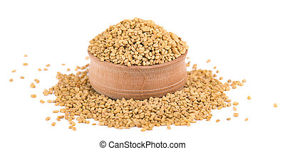 Fenugreek seeds in wooden bowl, isolated on white background