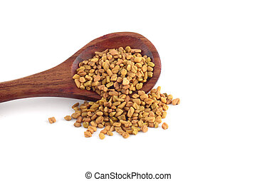Fenugreek seeds in wooden spoon isolated on white background