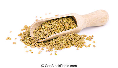Fenugreek seeds in wooden spoon, isolated on white background