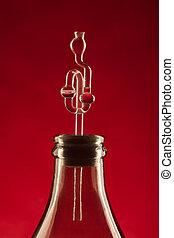 fermentation tube and demijohn on red background
