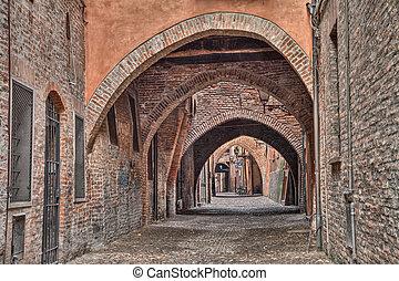 Ferrara, Italy, the medieval alley Via delle Volte -...