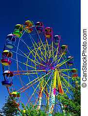 ferris whee - ferris wheel in the background of blue sky