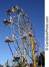 A ferris wheel and a blue sky.