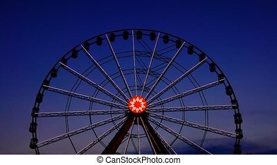 Ferris wheel against the background of the evening sky