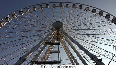 Ferris wheel against the blue sky. 4K.