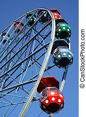 Ferris wheel agaist blue sky