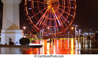 Ferris wheel and lighthouse in the Miracle Park at Night on...