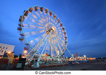 Ferris Wheel at amusement park - Ferris Wheel(motion) at...