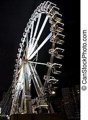 ferris wheel at night in an amusement park