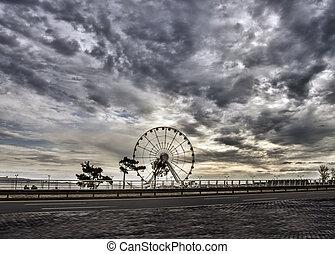 Ferris wheel at sea boulevard in Baku Azerbaijan. Cloudy landscape
