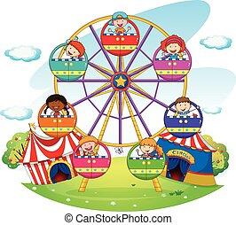 Ferris wheel - Children riding on ferris wheel  in the park