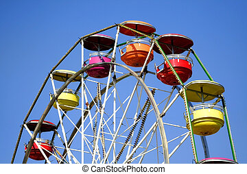 Ferris wheel - Colorful ferris wheel with blue sky...