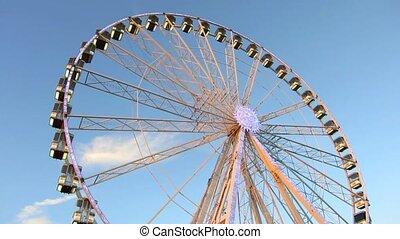 Ferris Wheel - Ferris wheel at sunset, blue sky background