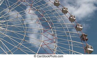 Ferris wheel   - Ferris wheel over blue sky. Time lapse