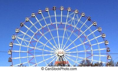 Ferris wheel footage HD. - Ferris wheel on the blue sky in...