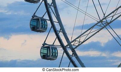 Ferris wheel illuminated at dusk