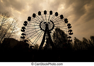 Ferris wheel in amusement park in Pripyat - Silhouette of...