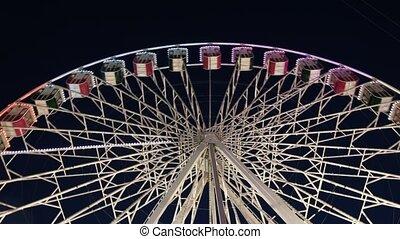 Ferris wheel in an amusement park at night