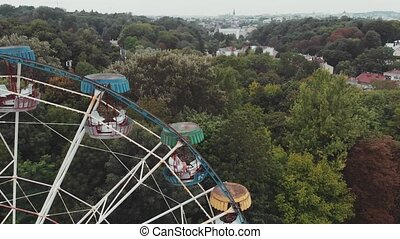 Ferris wheel in an amusement park on a background of Cloudy sky