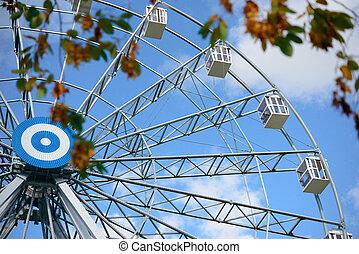 Ferris wheel in autumn park