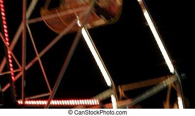 Ferris Wheel In Night Park With Decorative Lighting.