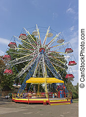 Ferris Wheel in park over blue sky