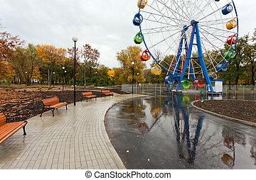 Ferris wheel in the autumn park