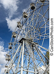 Ferris wheel in the city park. Autumn