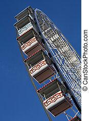 Ferris wheel in the deep blue sky