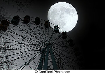Ferris wheel in the park - Ferris wheel and moon in the town...