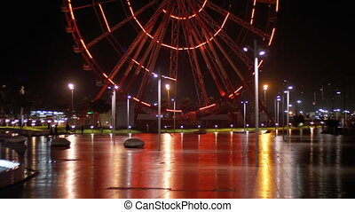 Ferris Wheel Lights at Night. Embankment of Batumi, Georgia...