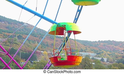 Ferris Wheel of bright color on a white background