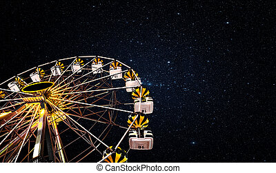 Ferris wheel on a background of the starry sky