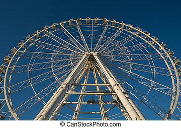 Ferris wheel on blue sky
