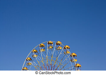 Ferris wheel on blue sky background on a clear day