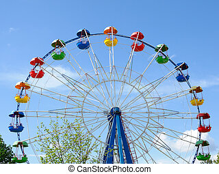 Ferris wheel on blue sky background