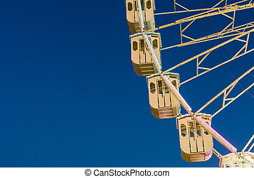 Ferris wheel on blue sky.