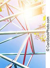 Ferris wheel on blue sky.