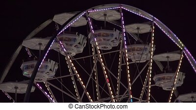 Ferris wheel on fair grounds. Shot in 4K RAW on a cinema...