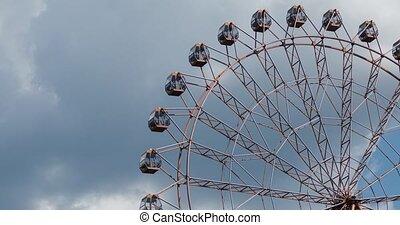 Ferris wheel on fun fair on blue sky white clouds background, timelapse video.