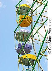 Ferris wheel on the blue sky background