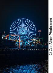 Ferris wheel on the Santa Monica Pier at night, in Santa Monica, Los Angeles, California