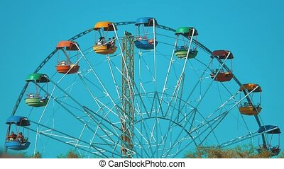 Ferris Wheel Over Blue Sky. famous ferris wheel at the...