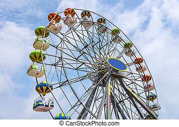 Ferris Wheel Over Blue Sky.