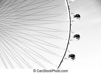 Ferris wheel over the sky in b&w