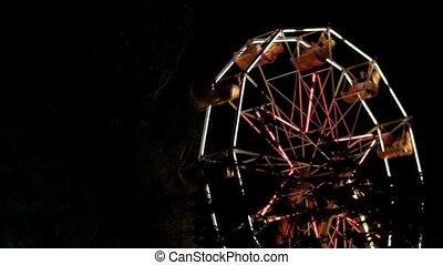 Ferris Wheel Rotates In A Park