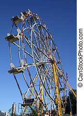 Ferris Wheel - A ferris wheel and a blue sky.