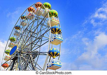 Ferris Wheel - Ferris wheel on the background of blue sky...