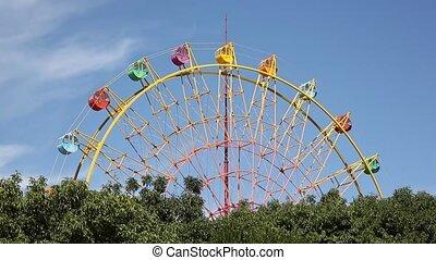 Ferris wheel  - view of a ferris wheel against the blue sky